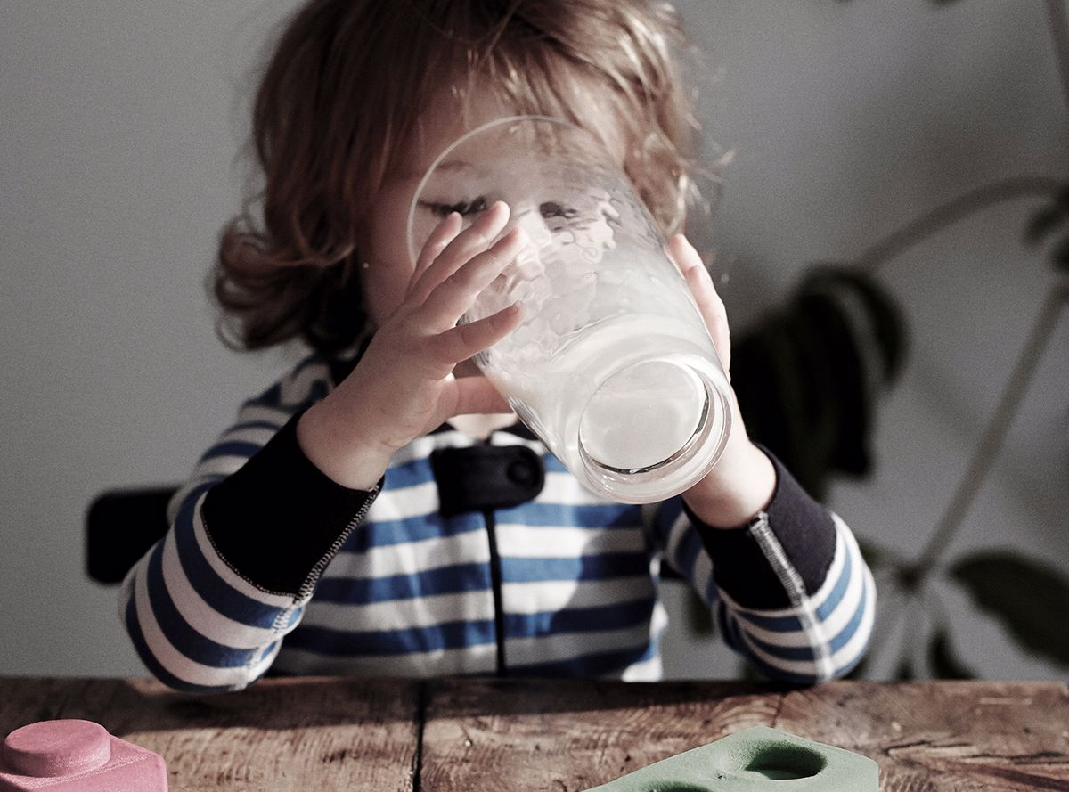 A child drinking a glass of milk