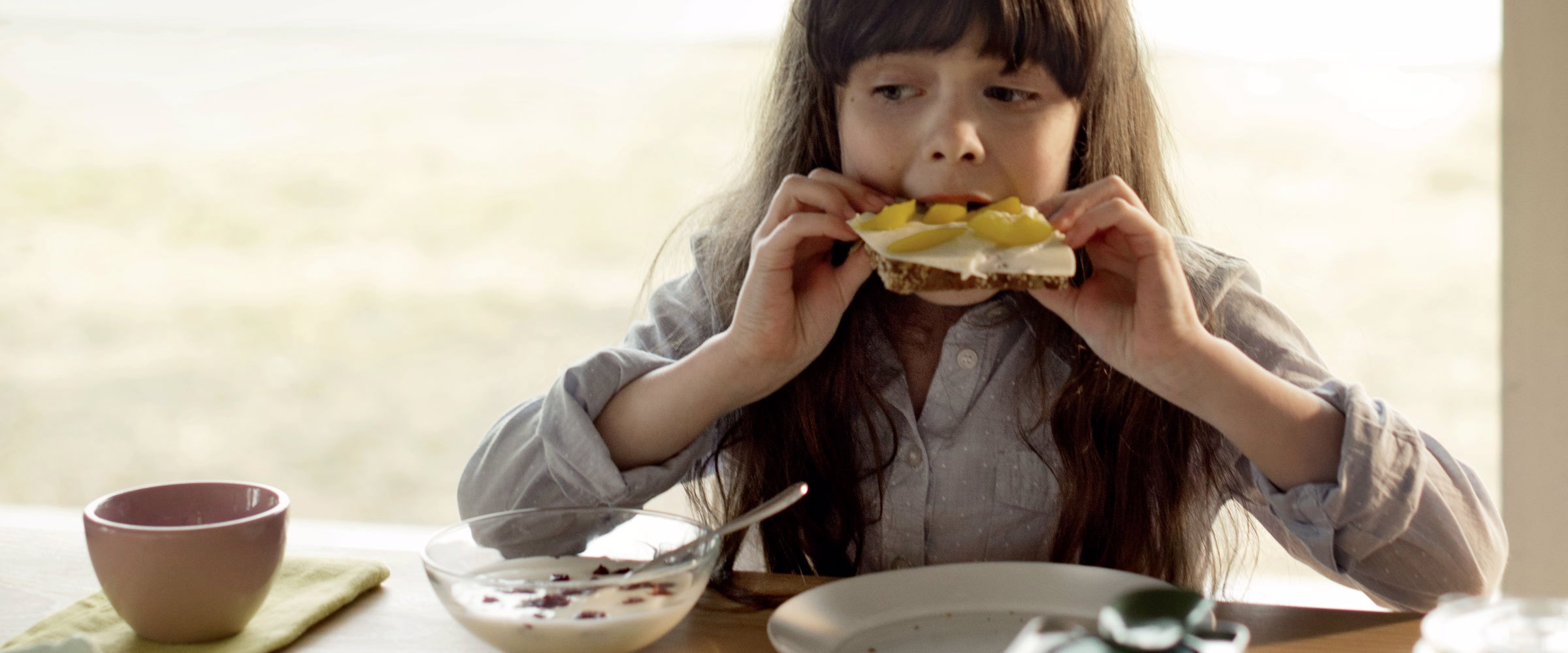 A girl eating toast