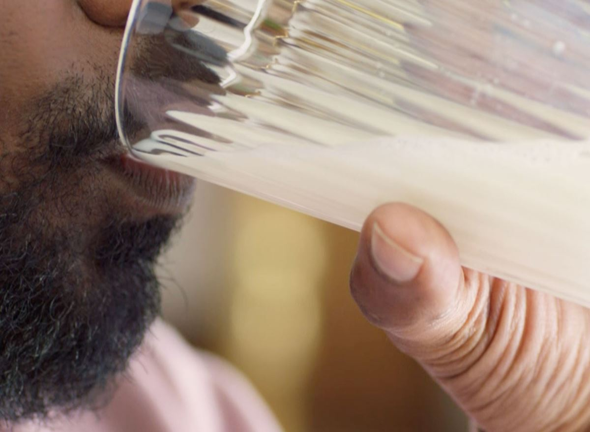 Close up on man drinking milk