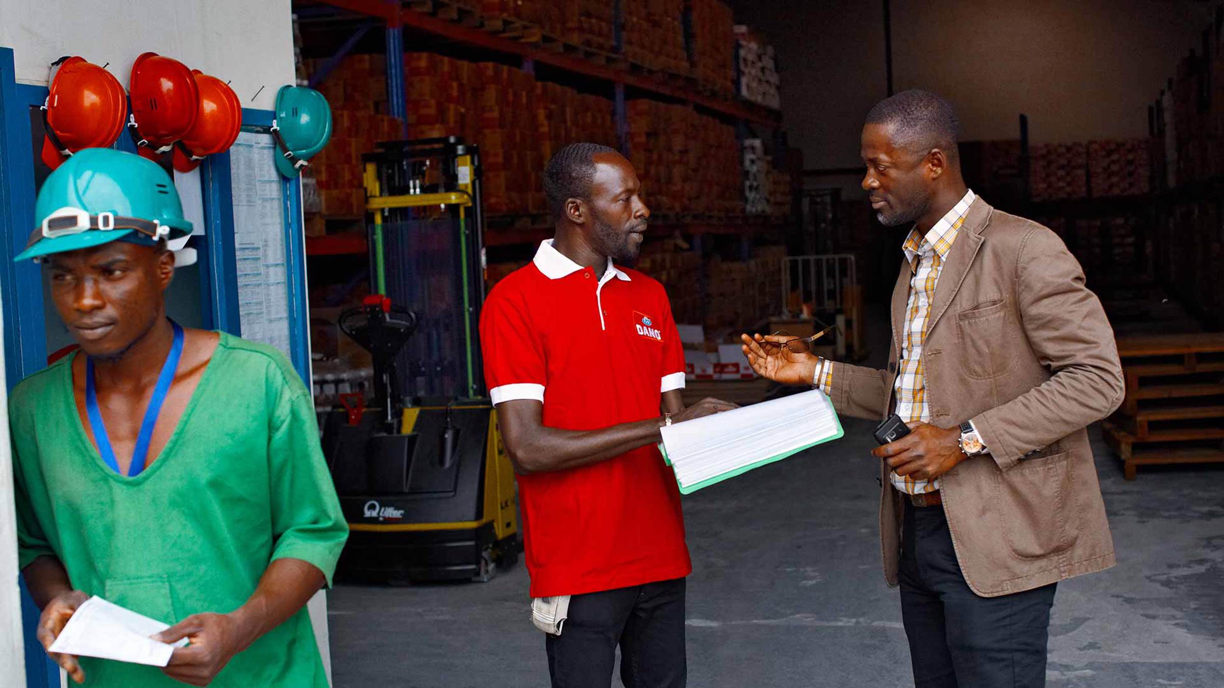 Arla workers talking at a warehouse