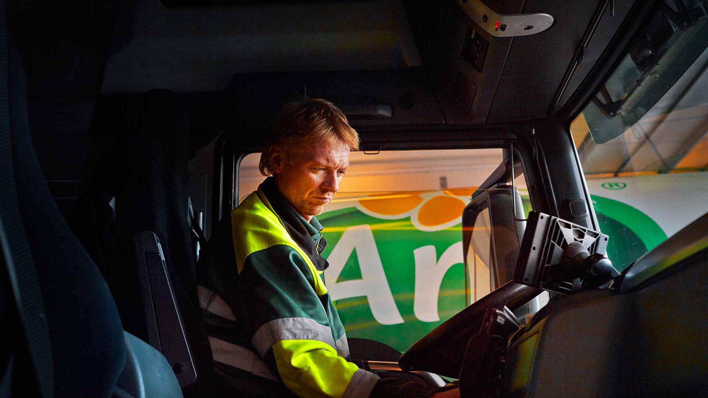 An Arla truck driver in his cab