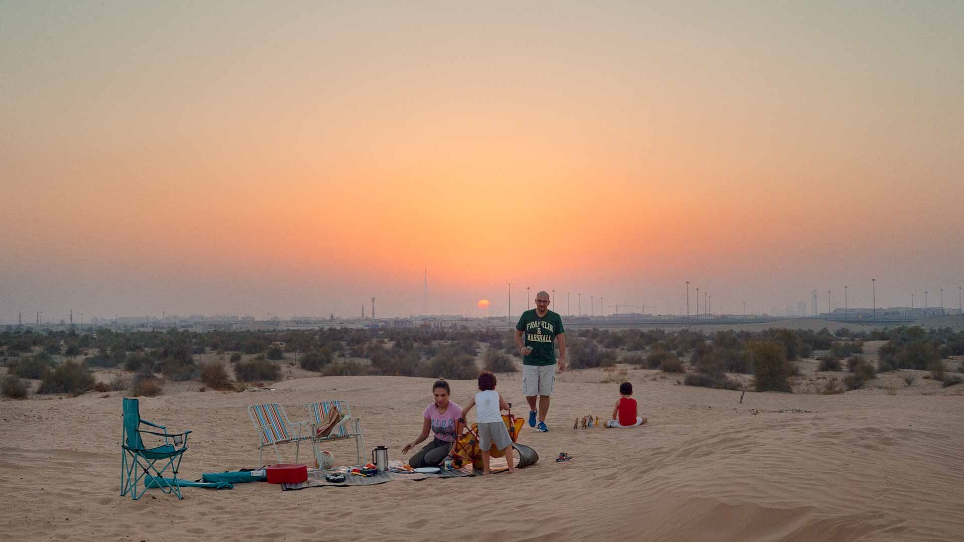 A family having a picnic in a desert