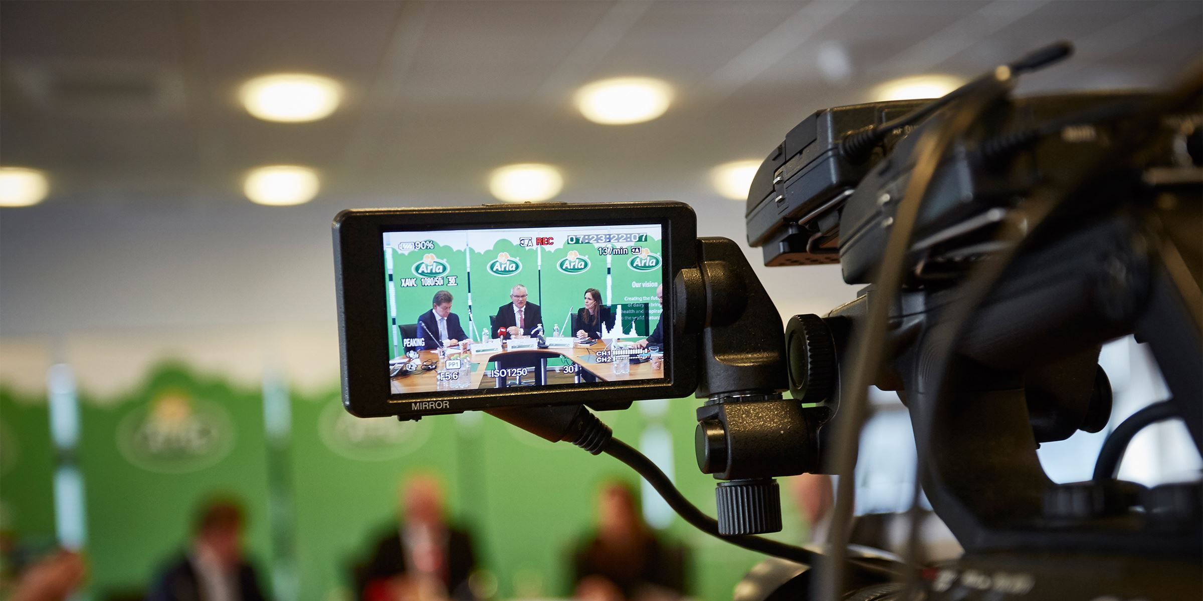 An Arla press meeting seen through the viewfinder of a camcorder