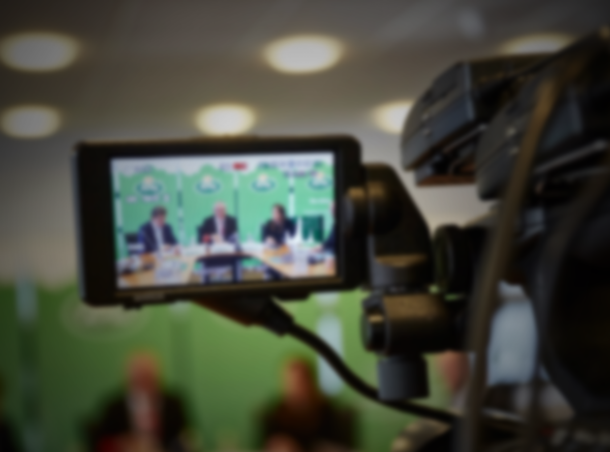 An Arla conference seen through the viewfinder of a video camera