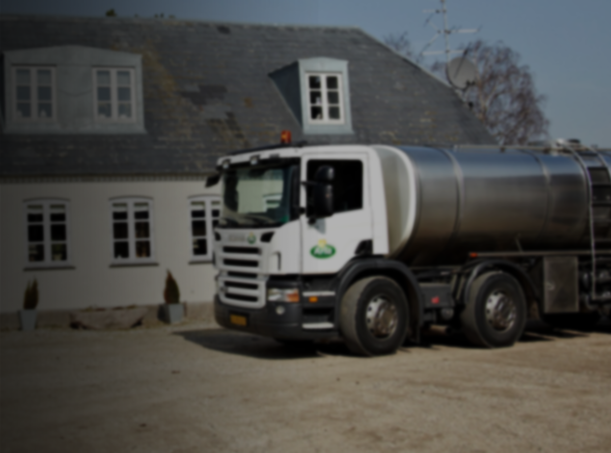 An Arla tanker in front of a rural building