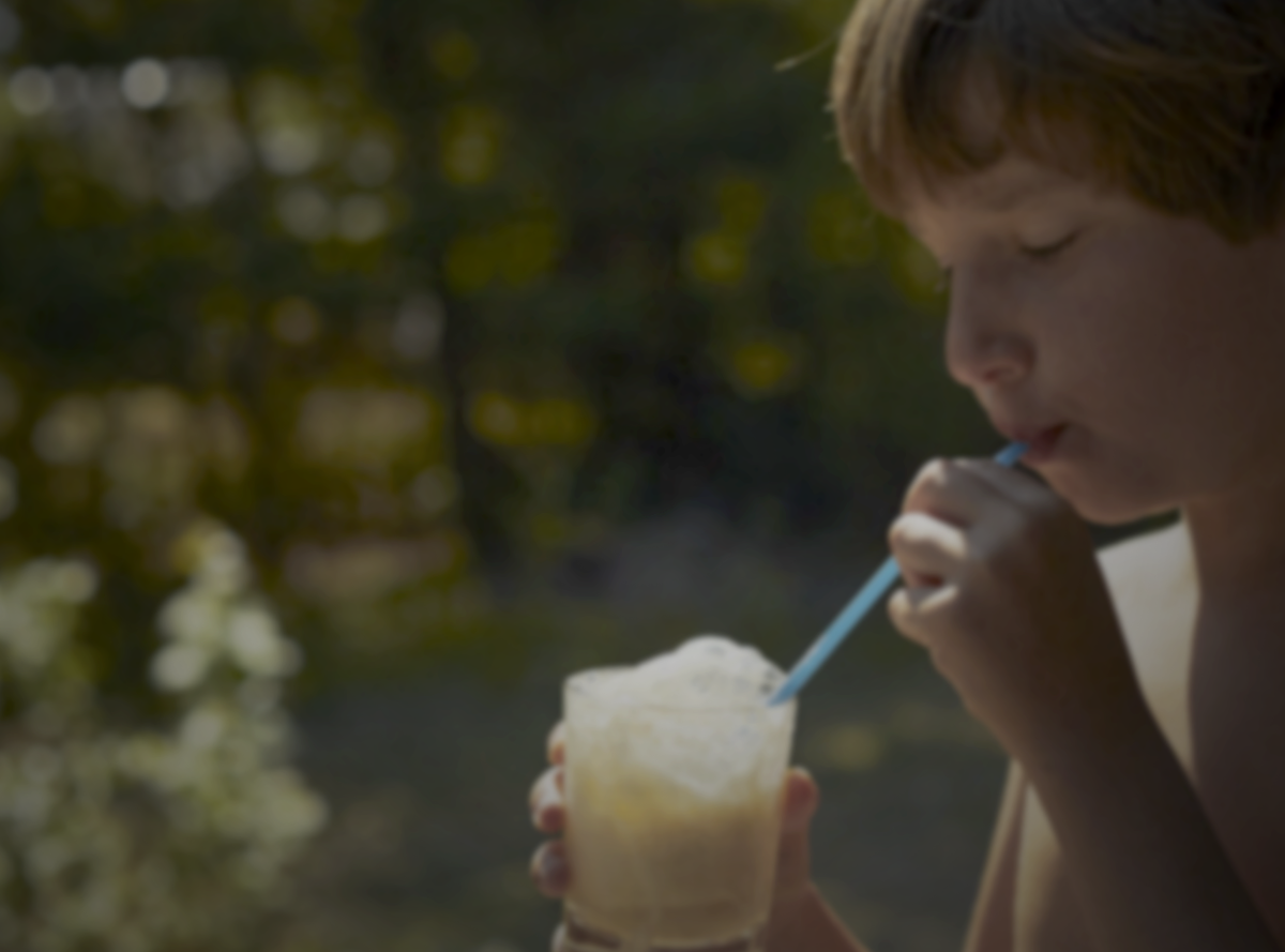Child drinking a milk drink outside