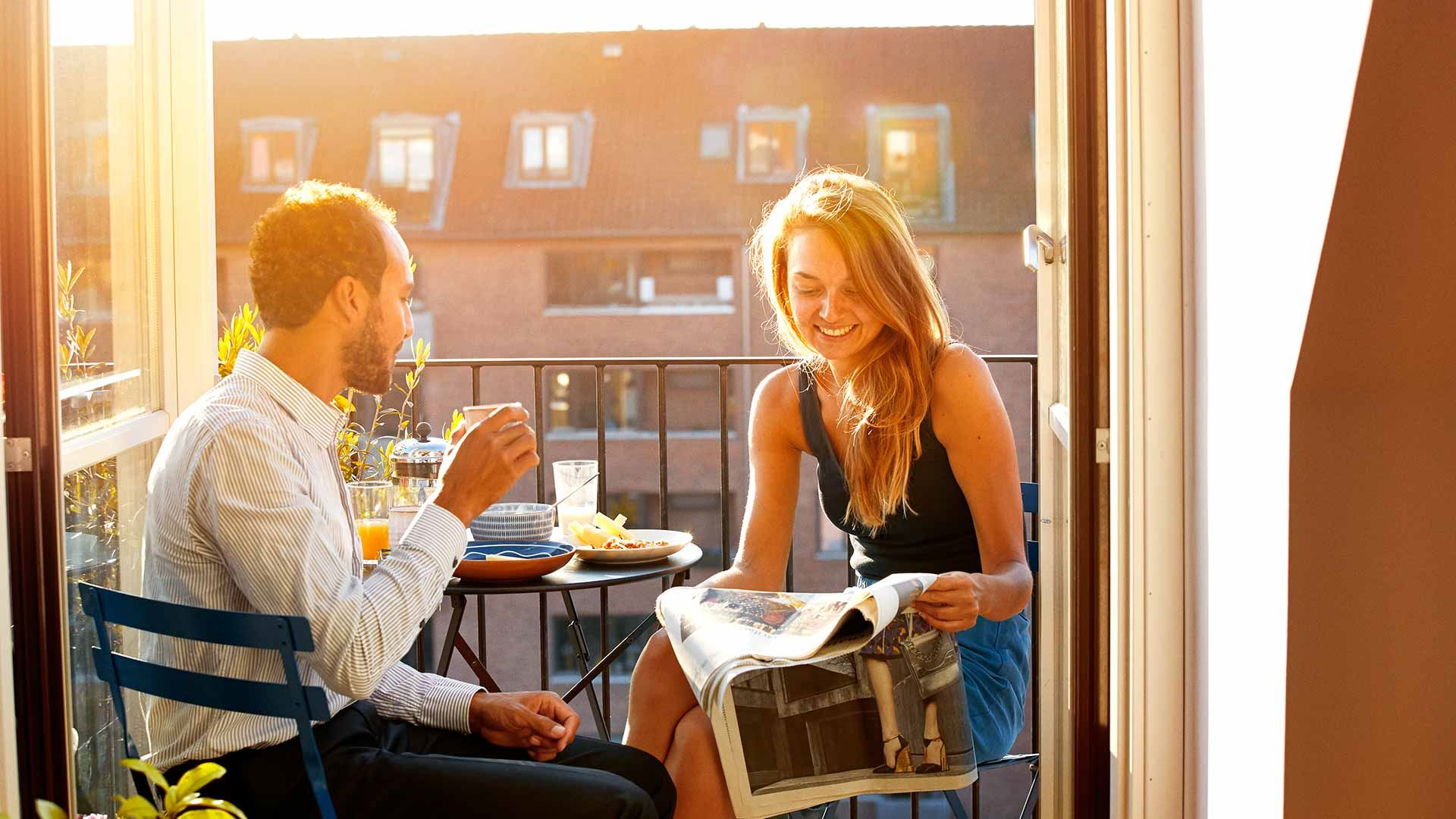 Couple dining together on a balcony