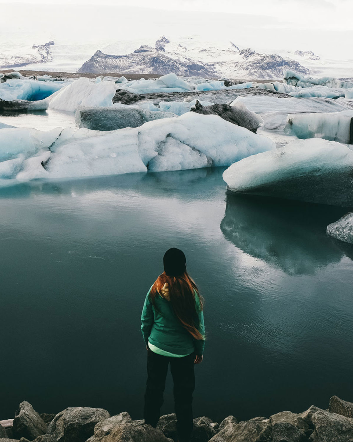 Woman looking out over an expanse of sea and ice