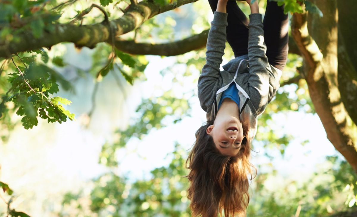Girl hanging from a tree